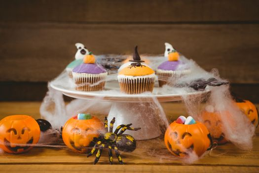 Sweet food on wooden table during Halloween