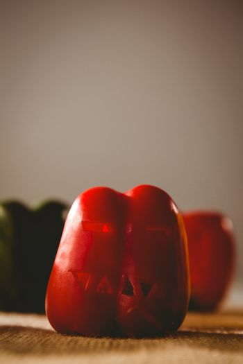 Carved red bell pepper on sack