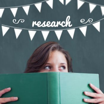 The word research and bunting against student holding book