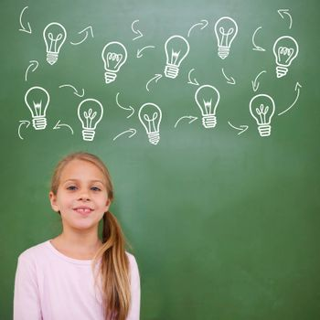 Composite image of idea and innovation graphic against cute pupil