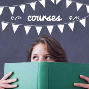 The word courses and bunting against student holding book