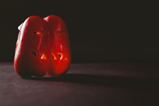 Carved red bell pepper on table