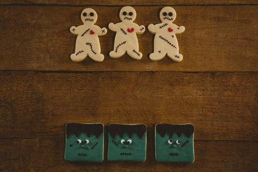 Overhead view of Halloween cookies arranged on wooden table
