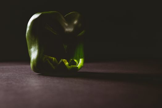 Carved green bell pepper on table