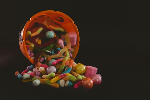 Orange bucket with various sweet food