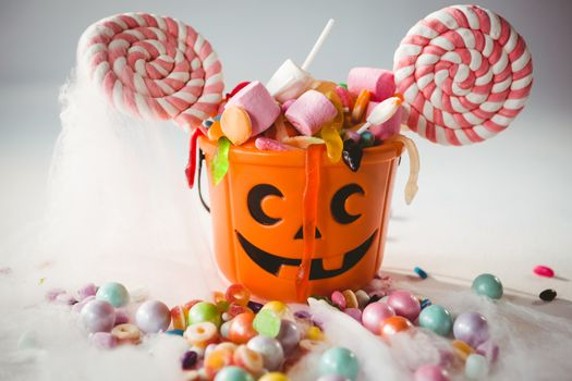 Bucket with various sweet food