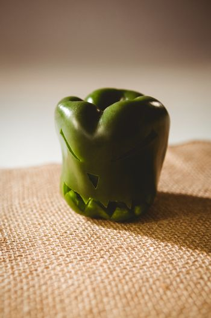 Carved green bell pepper on sack
