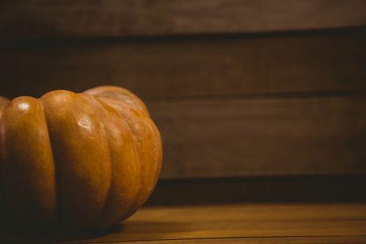 Pumpkin on wooden table during Halloween