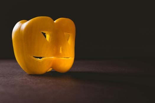 Carved yellow bell pepper on table
