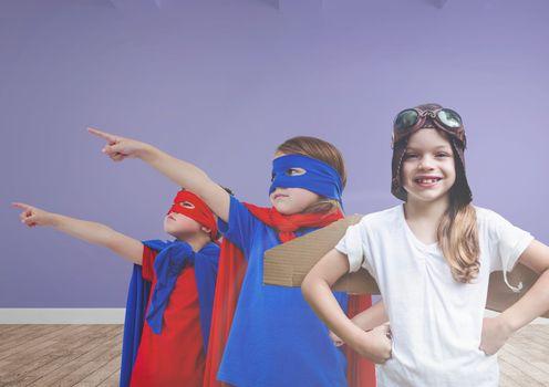 Kids in costumes in blank room