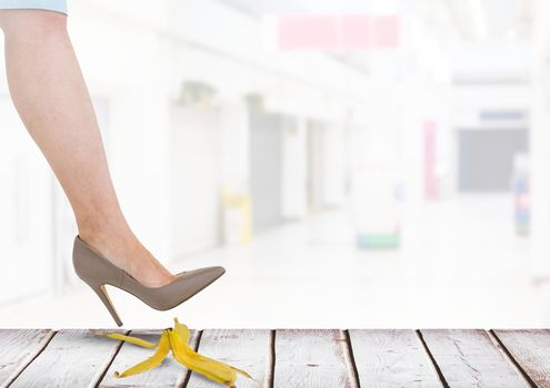 Woman stepping on banana peel about to slip mistake