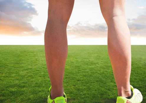Athletic legs on grass