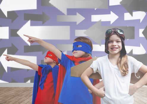 Kids in costumes in blank room with arrows