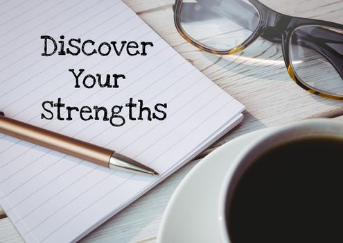 Discover your strengths  text written on page with glasses and coffee