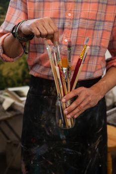 Man selecting a paintbrush