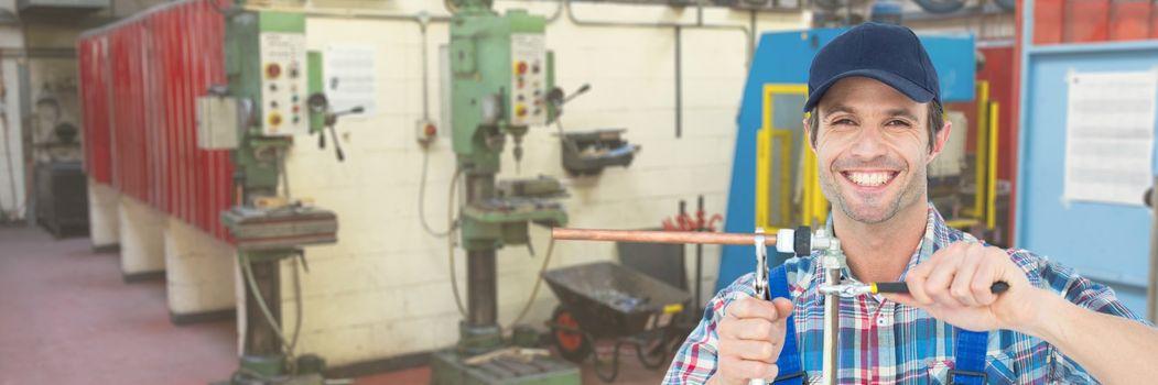 Happy mechanic man fixing pipes