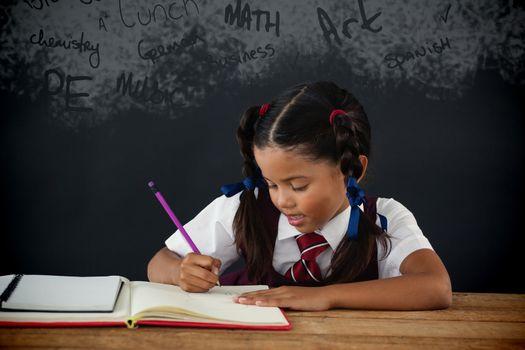 Text on black chalkboard against schoolgirl doing her homework against chalkboard