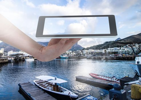 Holding tablet over marina
