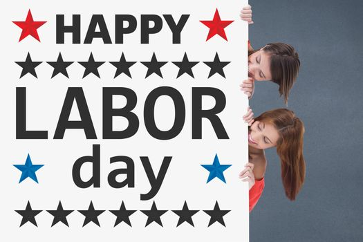 Women holding a Labor Day card