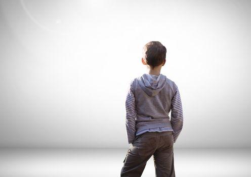 Boy looking into grey distance