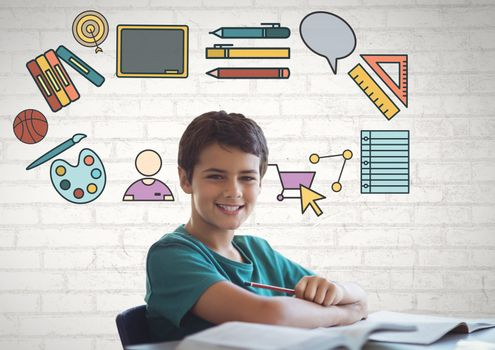 Digital composite of Boy in front of education graphics