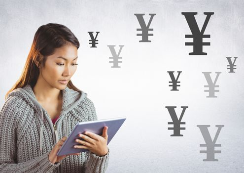 Woman on tablet with Yen currency icons