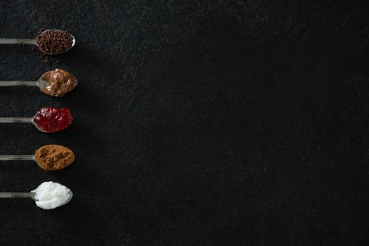 Various cookies seasoning ingredients in spoon
