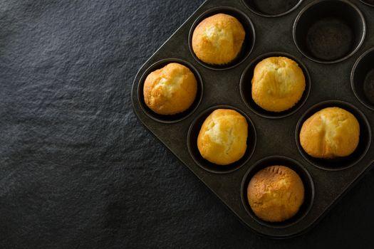 Plain cupcakes on baking tray