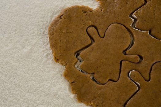 Flattened dough cut with a cookie cutter