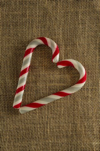 Heart shaped candy cane on on fabric