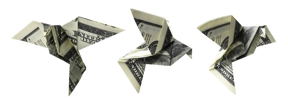 Hundred dollar bills in the shape of birds in flight on a white background.