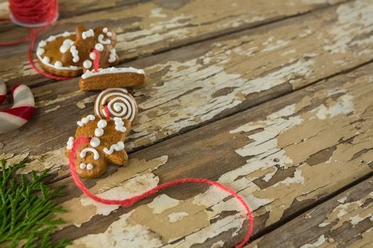 Gingerbread cookies arranged in string