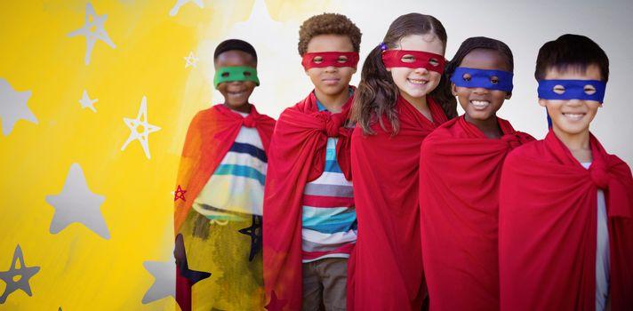 Composite image of smilnig children in superhero costumes