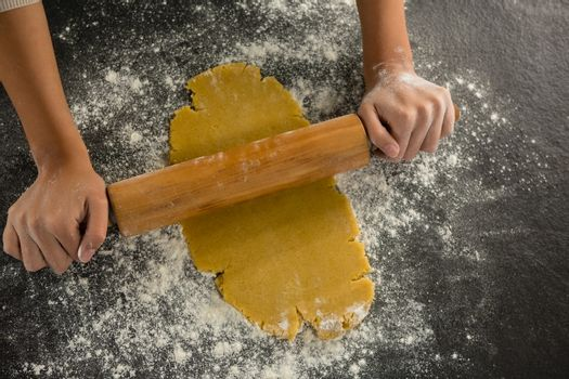 Hand baking dough with rolling pin