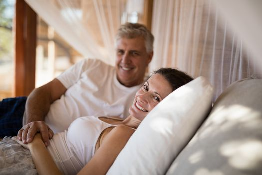 Senior couple sleeping on canopy bed