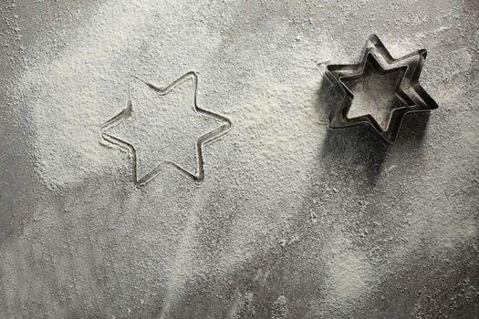 Star shape cutter on flour
