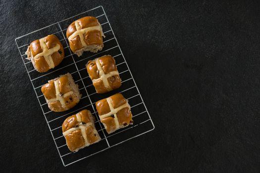 Hot cross bun on baking tray