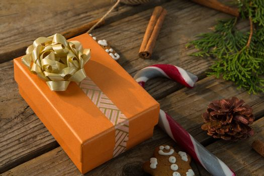 Close up of gift box by candy cane and spice