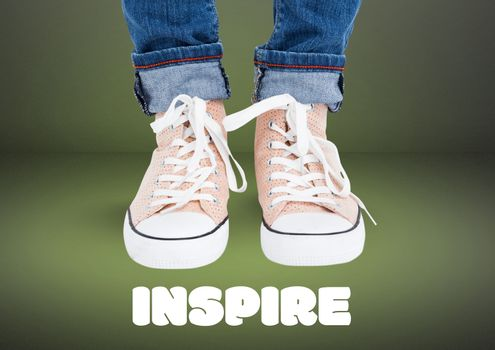 Inspire text and Beige shoes on feet with green background