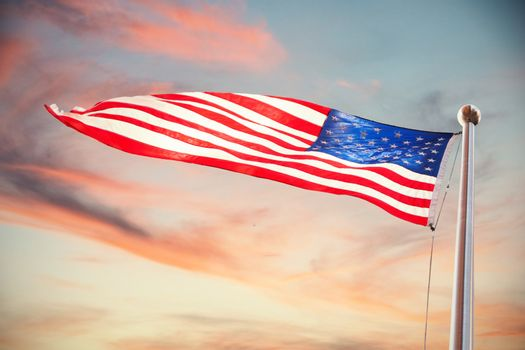 Composite image of american flag waving over white background