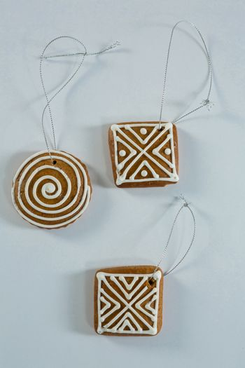 Overhead view of gingerbread cookie with strings