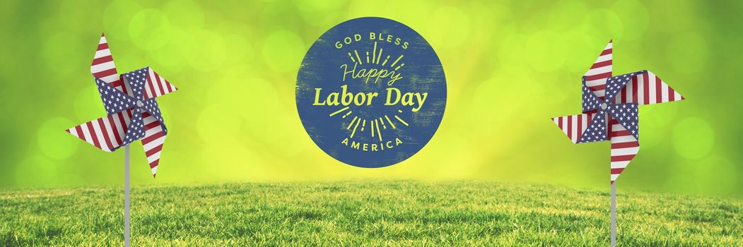 Digital composite of Happy labor day text and USA wind catchers in front of grass