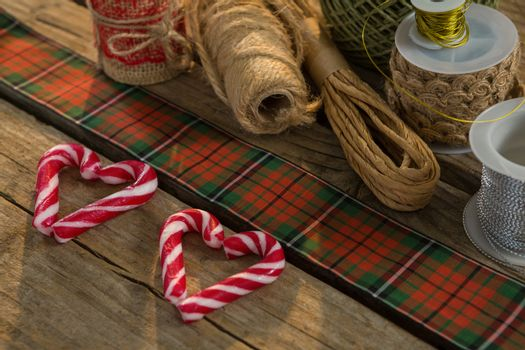 Close up of thread spools with candy cane