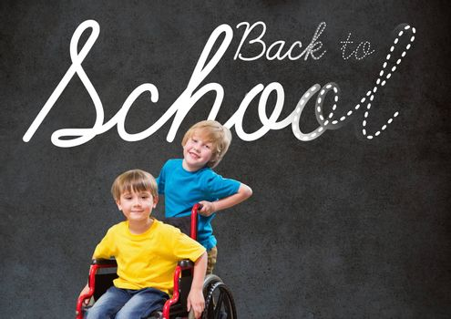 Digital composite of Back to school text on blackboard with disabled boy and friend in wheelchair