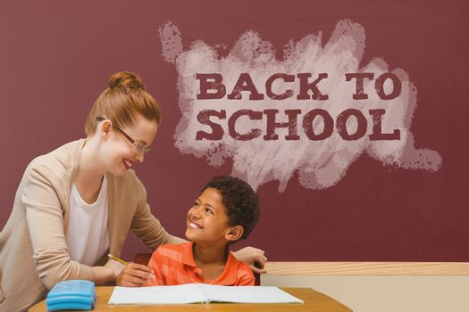 Digital composite of Student boy and teacher at table against red blackboard with back to school text