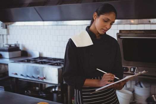Waitress with clipboard in cafe