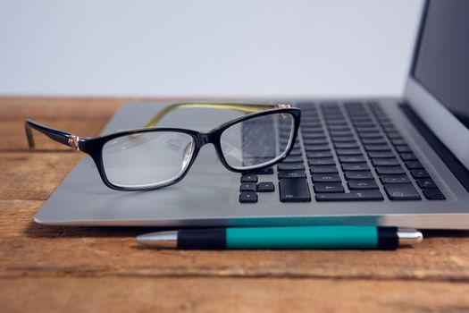Close-up of spectacles on laptop