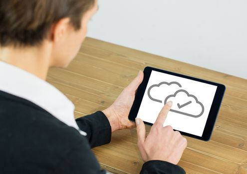 Cloud tick icons on tablet with hand