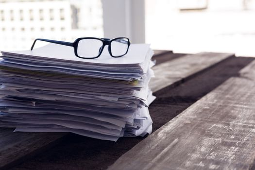 Close-up of spectacles on documents