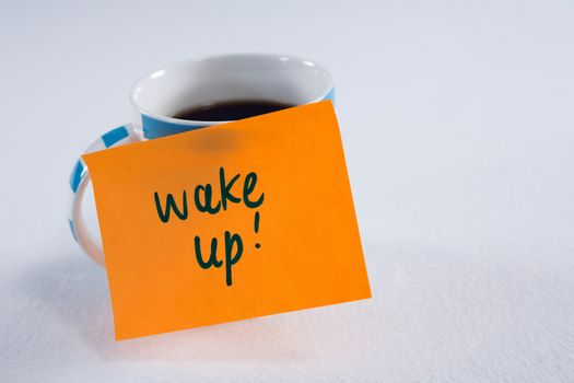 Black coffee with wake up message on white background